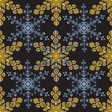 Reach christmas seamless background with hand-drawn realistic snowflake, golden color on black. Stock Photo