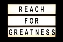 Reach for greatness hanging light box Royalty Free Stock Photography