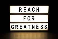 Reach for greatness light box sign board Stock Photos