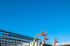 Reach lifters. Construction site against blue sky Stock Images