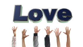 Reach for the love. Hands are grabbing the l-o-v-e letters Stock Images
