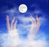 Reach for The Moon, Success, Ambition, Faith, Beleifs. Abstract, reaching for the moon stock photography