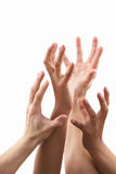 Reach out hand gesture from different skin tone. Hands, against white background Stock Photo