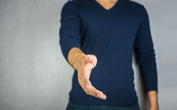 Reach out hand by man. On light grey background Stock Photos