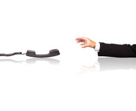 Reach for phone. Businessman hand reach for phone stock photography