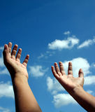 Reach for the skies. Hands raised unto the heavens as if in a gesture of spiritual supplication Royalty Free Stock Image