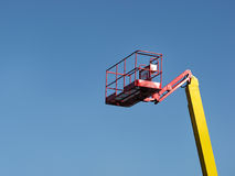 Reach for the Sky. Cherry picker isolated on blue sky royalty free stock photo