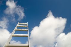 Reach for the Sky. Ladder reaching into the sky - business concepts etc Royalty Free Stock Photos