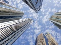 Reach for the sky, success concept. Looking up to skyscrapers. Dramatic perspective with low angle view of skyscrapers, Dubai. Vanishing point Stock Photos