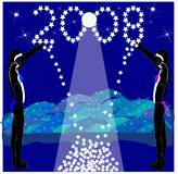 Reach for the stars in 2008. Night scene with two females on the beach reacing for the stars forming 2008 Stock Photo