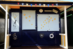 Reach for the stars beach hut. The front of a beach hut with decorated shutters and one line sayings at Sutton on Sea, Mablethorpe, Lincolnshire, England, UK Stock Photography