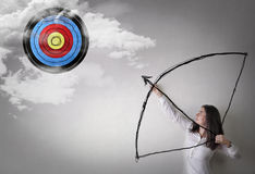 Reach the target. Young woman trying to reach her target Royalty Free Stock Image