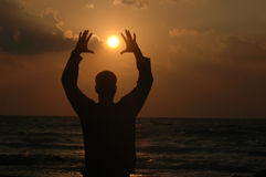 Reach to the sun. Mans silhouette Royalty Free Stock Photography