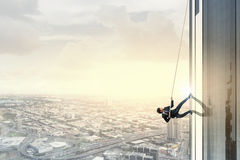 Reach the top. Concept of competition with businessman climbing office building with rope vector illustration
