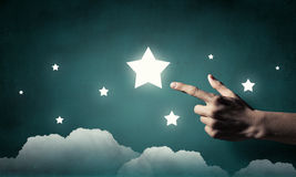 Reach and touch the star    . Mixed media Stock Images