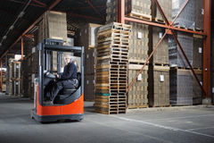 Reach truck driver in a warehouse Royalty Free Stock Photography