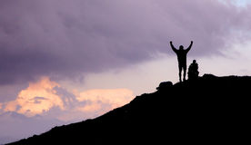 Man celebrating on mountain Royalty Free Stock Images