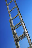 Reaching. A ladder with blue sky background Stock Images