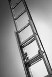 Reaching. A ladder lighted on gray background Royalty Free Stock Images