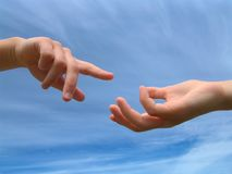 Reaching. Childrens hands reaching for each other Royalty Free Stock Photography