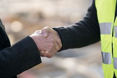 Reaching an agreement on construction site stock image