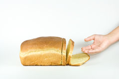 Reaching for bread. Royalty Free Stock Photos