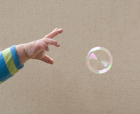 Reaching for the bubble Stock Photos