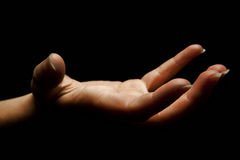 Reaching dark hand Stock Photo