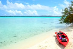Reaching a desert island by canoeing Stock Photography