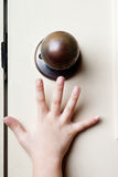 Reaching for door knob Stock Photo