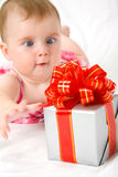 Reaching for gift box Stock Photo