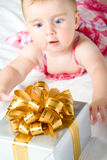 Reaching for gift box Royalty Free Stock Image
