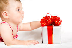 Reaching for gift box Stock Images