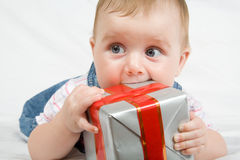 Reaching for gift box Stock Photography
