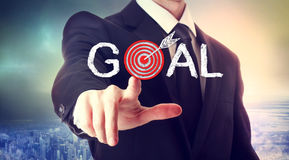 Reaching the Goal!. Business man pointing to the target, reaching the goal Royalty Free Stock Photo