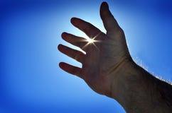 Reaching Hand to Heaven Seeking Light Stock Images