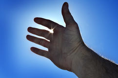 Reaching Hand to Heaven Seeking Light Royalty Free Stock Image