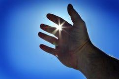 Reaching Hand to Heaven Seeking Light. Reaching hand to heaven seeking heavenly light Stock Photography