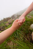 Reaching hands. Help of friend royalty free stock images