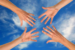 Reaching Hands Royalty Free Stock Photos