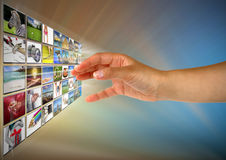 Reaching images on the screen Royalty Free Stock Photography
