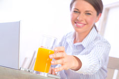 Reaching for juice Royalty Free Stock Images