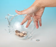 Reaching for the money Royalty Free Stock Photo