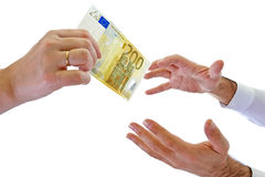 Reaching for money Royalty Free Stock Images