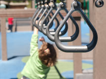 Reaching for the monkey bar. Swing bar handles in a row Royalty Free Stock Photo