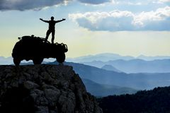 Reaching the mountains, freedom and peace. A man who challenges extraordinary spaces and challenging terrain conditions Stock Images