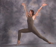 Reaching out. Dancer in lunge reaching up Stock Photo