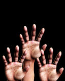 Reaching Out. An image of a set of hands outreaching