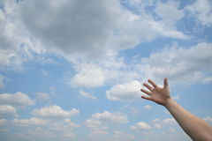 Reaching out. To heaven and above royalty free stock photography
