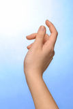 Reaching Out. Hand reaching out into the sky royalty free stock photo